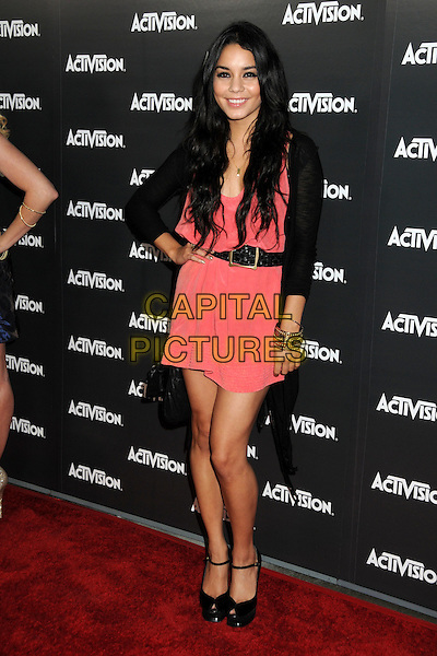 VANESSA HUDGENS .Activision E3 2010 Preview Event held at the Staples Center, Los Angeles, California, USA..June 14th, 2010.full length pink dress black belt jacket shoes ankle strap peep toe gold bracelets hand on hip.CAP/ADM/BP.©Byron Purvis/AdMedia/Capital Pictures.