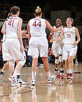 STANFORD, CA - January 21, 2012: Stanford Cardinal's Toni Kokenis and Nnemkadi Ogwumike congratulate Joslyn Tinkle during Stanford's 65-47 victory over Washington at Maples Pavilion.