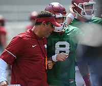 NWA Democrat-Gazette/ANDY SHUPE<br /> Arkansas offensive coordinator Dan Enos (left) speaks with quarterback Austin Allen Saturday, Aug. 5, 2017, prior to the start of a scrimmage in Razorback Stadium in Fayetteville. Visit nwadg.com/photos to see more photographs from the practice.