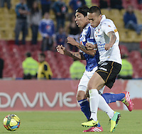 BOGOTÁ -COLOMBIA, 07-12-2013. Dayro Moreno (Izq.) jugador de Millonarios disputa el balón con Harrison Steve Henao (Der.) jugador de Once Caldas durante partido por la fecha 6 de los cuadrangulares finales de la Liga Postobón  II 2013 jugado en el estadio Nemesio Camacho el Campín de la ciudad de Bogotá./ Dayro Moreno (L) player of Millonarios fights for the ball with Harrison Steve Henao (R) player of Once Caldas during match for the 6th date of final quadrangulars of the Postobon  League II 2013 played at Nemesio Camacho El Campin stadium in Bogotá city. Photo: VizzorImage/Gabriel Aponte/STR
