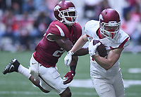 NWA Democrat-Gazette/J.T. WAMPLER Arkansas wide receiver River Warnock slip past defensive back Josh Liddell Saturday April 29, 2017 during a red-white scrimmage. The scheduled practice was closed to the general public and moved indoors because of thunderstorms.