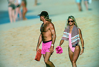 Freida Zamba (USA) at Sunset Beach Hawaii with her partner Flea. Circa 1989. Zamba is a four-time world surfing champion from the United States. She won three titles in a row from 1984 to 1986, then won again in 1988. She currently lives in Costa Rica. Photo: joliphotos.com