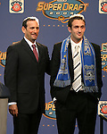16 January 2004: Ryan Cochrane (right) of Santa Clara University, with MLS Commissioner Don Garber (left), was selected with the fifth overall pick of the draft by the San Jose Earthquakes. The Major League Soccer SuperDraft was held at the Charlotte Convention Center in Charlotte, NC as part of the annual National Soccer Coaches Association of America convention...