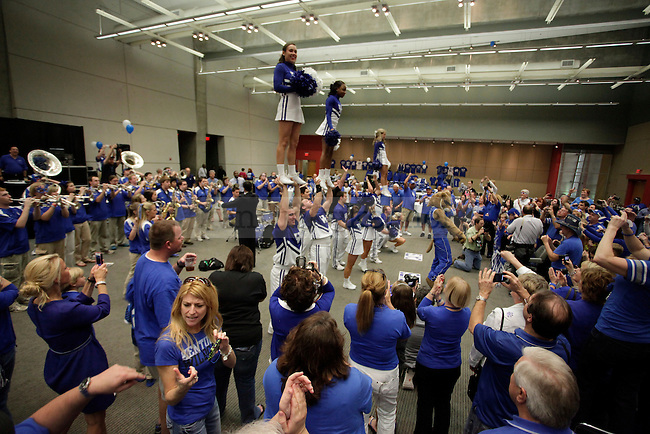 Fans celebrate during the University of Kentucky pep rally with the  band and cheerleaders at the Georgia World Congress Center, before the south regional semifinal of the NCAA Tournament, on Friday, March 23, 2012 in Louisville, Ky. Photo by Latara Appleby | Staff. Photo by Latara Appleby | Staff .