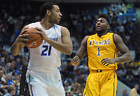 February 7, 2015 - Colorado Springs, Colorado, U.S. -  Air Force forward, DeLovell Earls #21, works against Cowboy, Charles Hankerson #1, during an NCAA basketball game between the University of Wyoming Cowboys and the Air Force Academy Falcons at Clune Arena, U.S. Air Force Academy, Colorado Springs, Colorado.  Air Force soars to a 73-50 win over Wyoming.