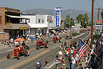 A tractor processions travels down U.S. 395 past downtown Gardnerville, Nev. during the annual Carson Valley Days Parade