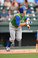 First baseman Joe Dudek (26) of the Lexington Legends bats runs out a grounder in a game against the Greenville Drive on Friday, June 30, 2017, at Fluor Field at the West End in Greenville, South Carolina. Lexington won, 17-7. (Tom Priddy/Four Seam Images)