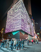 Vornado Realty Trust and its partners debuts the giant one-block long, eight-story high digital display on the Marriott Marquis Hotel in Times Square in New York on Tuesday, November 18, 2014. The largest and highest resolution sign, at 24 million pixels, in Times Square, advertising costs over $2.5 million a month with Google taking ads starting on Monday.  (© Richard B. Levine)