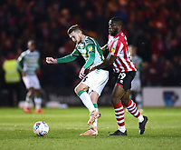 Yeovil Town's Tom James shields the ball from Lincoln City's John Akinde<br /> <br /> Photographer Andrew Vaughan/CameraSport<br /> <br /> The EFL Sky Bet League Two - Lincoln City v Yeovil Town - Friday 8th March 2019 - Sincil Bank - Lincoln<br /> <br /> World Copyright © 2019 CameraSport. All rights reserved. 43 Linden Ave. Countesthorpe. Leicester. England. LE8 5PG - Tel: +44 (0) 116 277 4147 - admin@camerasport.com - www.camerasport.com