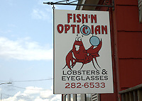 "The owner of these two businesses is typical of the versatility and adaptability one must have to live on the coast of Maine. Neither optometry nor lobster fishing is a 12 month money making enterprise. I spoke to a lady as she was coming out of the store; she was wearing new spectacles and clutching a 3 lb lobster destined fir tonight's ""suppah""."