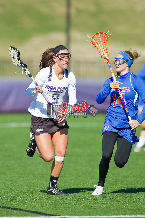 Patricia Bigelow (9) of the High Point Panthers is defended by Nora Barry (14) of the Florida Gators during second half action at Vert Track, Soccer & Lacrosse Stadium on February 17, 2013 in High Point, North Carolina.  The Gators defeated the Panthers 13-7.   (Brian Westerholt/Sports On Film)