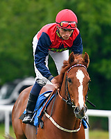 Simbirsk ridden by Kieran Shoemark goes down to the start of The DEOS Group Handicap during Evening Racing at Salisbury Racecourse on 11th June 2019