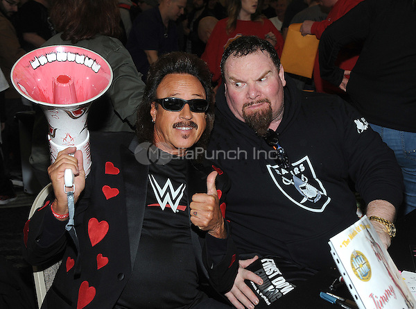 "NEW YORK, NY - MARCH 04:  Hall of Fame members Jimmy Hart and Jim ""The Anvil"" Neidhart attends the ""Big Event"" at the LaGuardia Plaza Hotel on March 4, 2017 in New York City.  Photo by: George Napolitano/ MediaPunch"