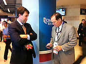 Former North Carolina representative Jim Harrell III and Kieran Shananah, an attorney in Raleigh who has represented the Wake County school board, discuss political compromise outside of the official Romney Paul store in the Tampa Times Forum, the site of the 2012 RNC.  Harrell, who represented Surry County in the state legislature from 2002-2008, is now a lobbyist representing PSNC Energy. He said he will be traveling to both major party conventions.