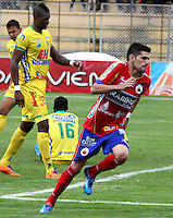 PASTO- COLOMBIA -05 -04-2014: Silvio Bosco Frontan,jugador de Deportivo Pasto celebra el gol anotado al Atletico Huila durante partido entre Deportivo Pasto y Atletico Huila por la fecha 15 entre de la Liga Postobon I 2014, jugado en el estadio Departamental Libertad de la ciudad de Pasto. /  Silvio Bosco Frontan,player of Deportivo Pasto celebrates a scored goal tof Atletico Huila during a match between Deportivo Pasto and Atletico Huila for the date 15th of the Liga Postobon I 2014 at the Departamental Libertad Stadium in Pasto city. Photo: VizzorImage  / Leonardo Castro / Str.
