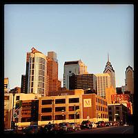 The late afternoon sun lights the Philadelphia skyline as seen from the Chestnut Street Bridge December 19, 2012.