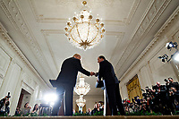 U.S. President Donald Trump, left, shakes hands with Stefan Lofven, Sweden's prime minister, during a news conference in the East Room of the White House in Washington, D.C., U.S., on Tuesday, March 6, 2018. Trump and Lofven are looking to focus on trade and investment between the two countries and ways to achieve shared defense goals. <br /> CAP/MPI/RS<br /> &copy;RS/MPI/Capital Pictures