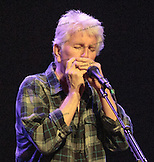 Graham Nash on harmonica.  David Crosby, Graham Nash and very special guests at the Maui Arts &  Cultural Center.  A concert for Ruthie on August 29, 2013.