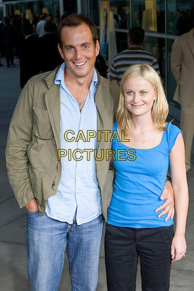 "WILL ARNETT & AMY POEHLER.""The 40 Year-Old Virgin"" Premiere,.held at The Arclight Cinema,.Los Angeles, 11th August 2005.half length denim jeans black trousers turquoise blue top shirt beige taupe jacket .www.capitalpictures.com.sales@capitalpictures.com.© Capital Pictures."