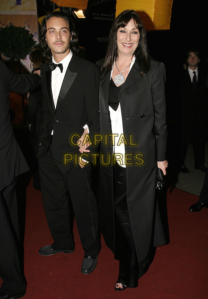 ANJELICA HUSTON & GUEST.Official BAFTA Aftershow Dinner Party, .Grosvenor House, Park lane, London, .February 12th 2005..full length .Ref: AH.www.capitalpictures.com.sales@capitalpictures.com.©Capital Pictures.