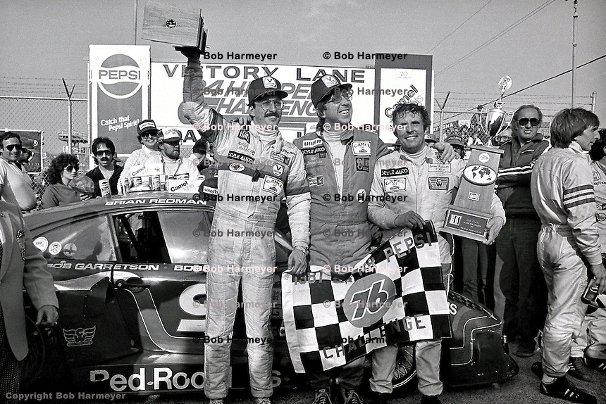 Bobby Rahal, Bob Garretson and Brian Redman celebrate in victory lane after winning the 1981 race by a margin of 13 laps.