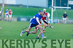 Cian Hussey of St Brendans tries to get past Causeway's Keith Carmody in the Division 1 County Hurling League final