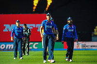 England's Stuart Broad walks off with the England team after the ICC Cricket World Cup one day pool match between the New Zealand Black Caps and England at Wellington Regional Stadium, Wellington, New Zealand on Friday, 20 February 2015. Photo: Dave Lintott / lintottphoto.co.nz