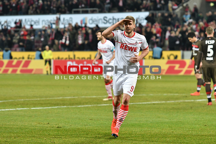 08.02.2019, Rheinenergiestadion, K&ouml;ln, GER, DFL, 2. BL, VfL 1. FC Koeln vs FC St. Pauli, DFL regulations prohibit any use of photographs as image sequences and/or quasi-video<br /> <br /> im Bild Torschuetze Simon Terodde (#9, 1.FC K&ouml;ln / Koeln) salutiert nach seinem Tor zum 4:1<br /> <br /> Foto &copy; nph/Mauelshagen