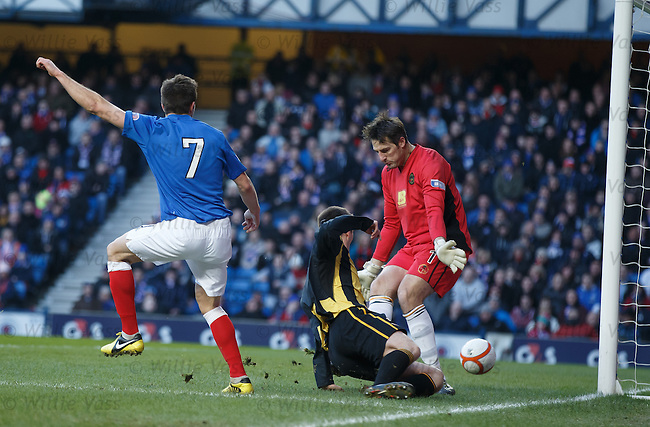 Andy Little pounces to score the opening goal for Rangers through the legs of Berwick defender Chris Townsley and keeper Ian McCaldon