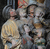 People in the crowd listening to St Saulve praying for the discovery of the tomb of St Firmin, Gothic style polychrome high-relief sculpture from the South side of the choir screen, 1490-1530, commissioned by canon Adrien de Henencourt, depicting the life of St Firmin, at the Basilique Cathedrale Notre-Dame d'Amiens or Cathedral Basilica of Our Lady of Amiens, built 1220-70 in Gothic style, Amiens, Picardy, France. St Firmin, 272-303 AD, was the first bishop of Amiens. Amiens Cathedral was listed as a UNESCO World Heritage Site in 1981. Picture by Manuel Cohen