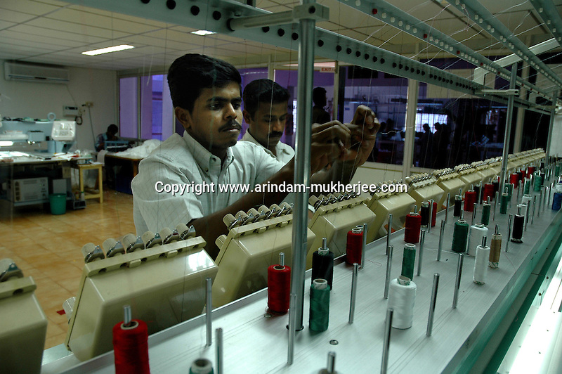 Indian men working at Prime Tex garment embroidery factory in Tirupur, Tamilnadu. After lifting of quota system in textile export on 1st january 2005. Tirupur has become the biggest foreign currency earning town of India.