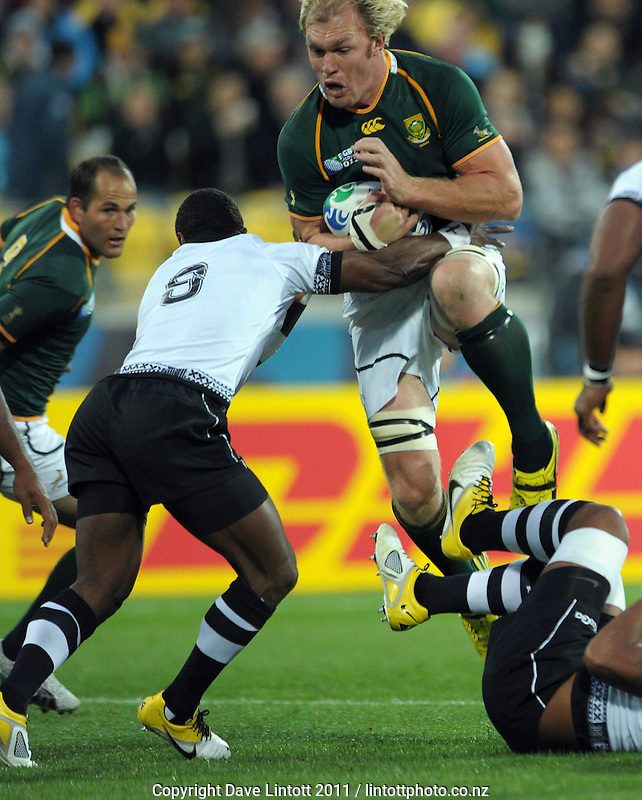 Sprinboks flanker Schalk Burger leaps over a tackler during the South Africa versus Fiji pool D match of the 2011 IRB Rugby World Cup at Wellington Regional Stadium, Wellington, New Zealand on Saturday, 17 September 2011. Photo: Dave Lintott / lintottphoto.co.nz