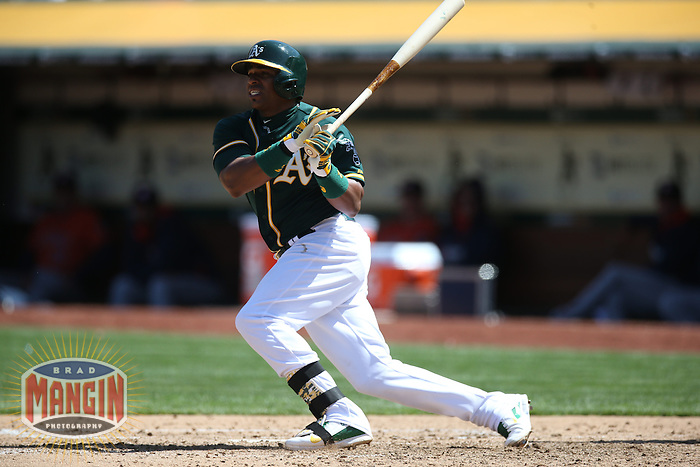 OAKLAND, CA - APRIL 19:  Yoenis Cespedes #52 of the Oakland Athletics bats against the Houston Astros during the game at O.co Coliseum on Saturday, April 19, 2014 in Oakland, California. Photo by Brad Mangin