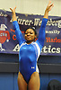 Nicole Jackson of Half Hollow Hills turns to the judges after springing from the vault in the NYSPHSAA varsity gymnastics state championship meet at Cold Spring Harbor High School on Saturday, March 3, 2018.