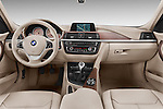 Straight dashboard view of a 2012 - 2014 BMW 3-Series 320d Modern 4 Door Sedan.