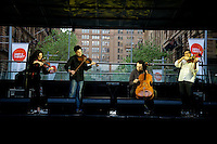 FourPlay String Quartet performing at the ART & ABOUT 10th birthday party