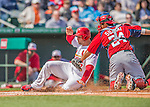 2 March 2013: St. Louis Cardinals outfielder Matt Holliday is tagged sliding home by catcher Kurt Suzuki during a Spring Training game against the Washington Nationals at Roger Dean Stadium in Jupiter, Florida. The Nationals defeated the Cardinals 6-2 in their first meeting since the NLDS series in October of 2012. Mandatory Credit: Ed Wolfstein Photo *** RAW (NEF) Image File Available ***