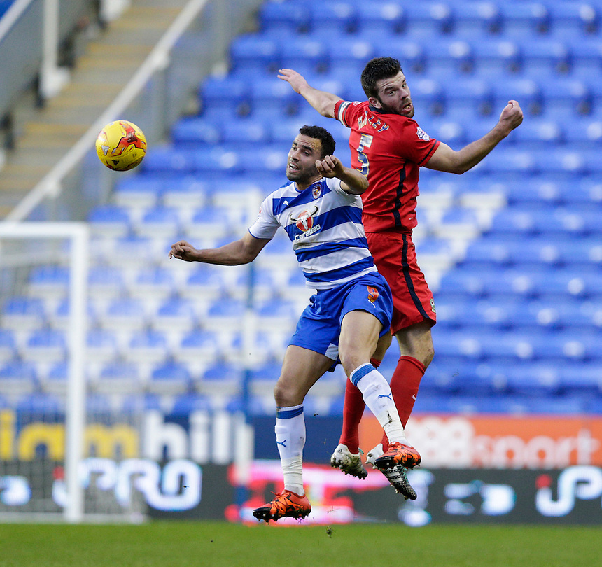 Blackburn Rovers' Grant Hanley battles for possession with Reading's Hal Robson-Kanu<br /> <br /> Photographer Craig Mercer/CameraSport<br /> <br /> Football - The Football League Sky Bet Championship - Reading v Blackburn Rovers - Sunday 20th December 2015 - Madejski stadium - Reading<br /> <br /> &copy; CameraSport - 43 Linden Ave. Countesthorpe. Leicester. England. LE8 5PG - Tel: +44 (0) 116 277 4147 - admin@camerasport.com - www.camerasport.com