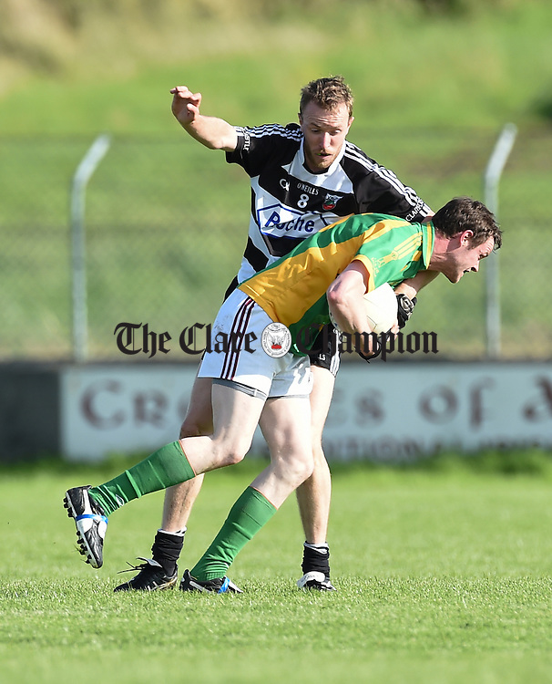 Patrick Kelly of Clarecastle in action against Aidan Malone of Kilfenora during their Intermediate Championship Round 3 game in Quilty. Photograph by John Kelly.