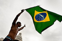 A protester waves the Brazilian flag during the protest march in Salvador, Bahia, Brazil, 1 February 2012.