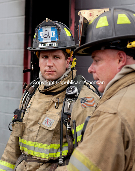WOLCOTT, CT-13 September 2013-091313BF10- Waterbury Fire Department recruit Eric Miller, 28, from Waterbury, listens to an instructor during training at the Wolcott Fire Academy during a live burn exercise Friday in Wolcott. He is one of 19 recruits who will graduate in October after 11 weeks of training.  Bob Falcetti Republican-American