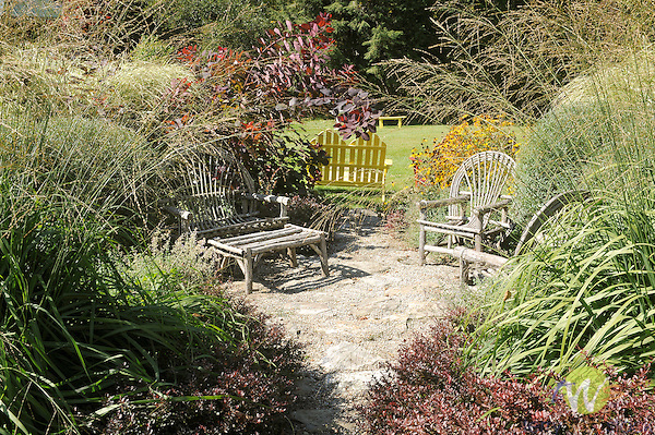 Weston Inn fall garden with wicker chair.