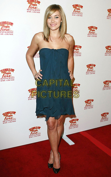 LAUREN CONRAD.Hawaiian Tropic Zone inside the Miracle Mile Shops at Planet Hollywood Casino and Resort, Las Vegas, NV, USA..January 26th, 2008.full length dress hand on hip blue strapless .CAP/ADM/MJT.©MJT/AdMedia/Capital Pictures. *** Local Caption *** .