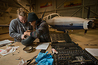 Aviation Maintenance Technology students Randy Sorenson, left, and Desmond Corpuz, right, disassemble and inspect the landing gear from a Piper Tomahawk during AMT 273 Aircraft Fluid Power Systems at UAA's Aviation Technology Complex on Merrill Field.
