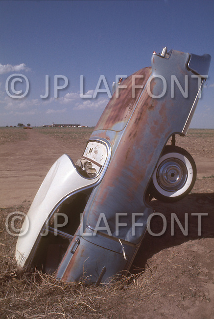 Original site of Artist Stanley Marsh's 'Cadillac Ranch' which set a row of old Cadillac cars set in a field alongside a highway in Amarillo, Texas. May 7, 1977. It was created in 1974 by Chip Lord, Hudson Marquez and Doug Michels, who were a part of the art group Ant Farm. These images were shot in it's original location. It was moved 2 miles to the West in 1997 to the west, to a cow pasture along Interstate 40