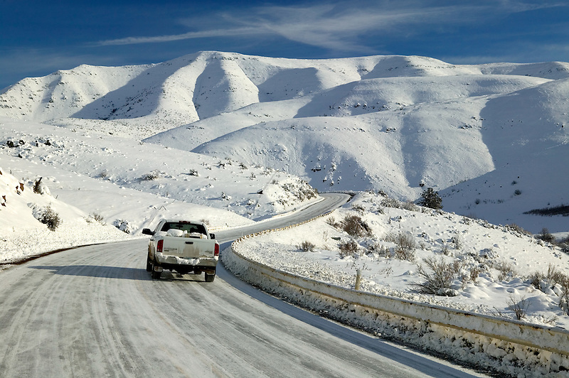 Road from Halfway to Hell's Canyon with snow and truck. Oregon