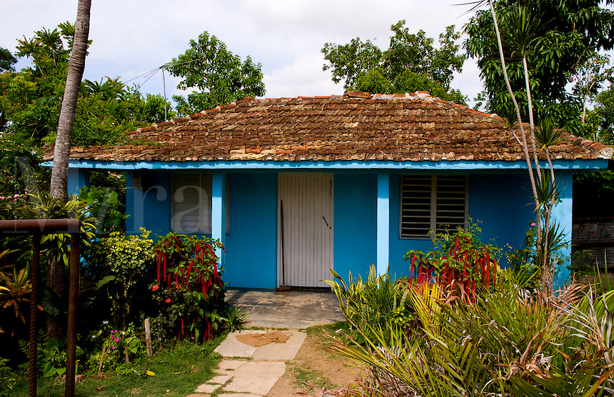 Local house painted blue in small village of Manaca Iznaca Estate home of the Plantation House near Trinidad Cuba