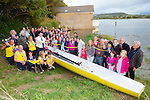 Brendan Griffin TD cuts the tape to officially launch the Callinafercy Rowing Club new boat 'Lir' at their boathouse on Tuesday evening