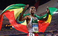 17 AUG 2008 - BEIJING, CHN - Kenenisa Bekele (ETH) celebrates winning the Mens 10000m final in a new Olympic Record time of 27 minutes 1.17 seconds -  Beijing Olympics. (PHOTO (C) NIGEL FARROW) *** IOC RULES APPLY ON USAGE ***