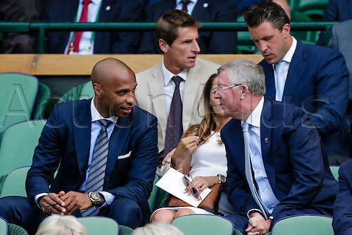 10.07.2015.  Wimbledon, England. The Wimbledon Tennis Championships.  Gentlemens Singles Semi-Final match between third seed Andy Murray (GBR) and second seed Roger Federer (SUI).  Thierry Henry chats to Sir Alex Ferguson in the Royal Box
